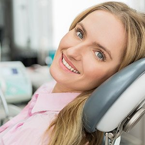 Smiling woman in dental chart